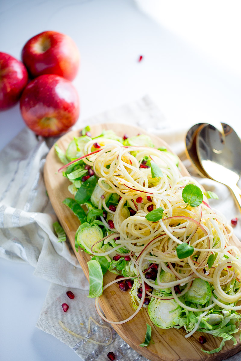 This apple salad with brussels sprouts, pomegranate seeds, and an epic maple-balsamic vinaigrette is delicious, nutritious and very easy to prepare.