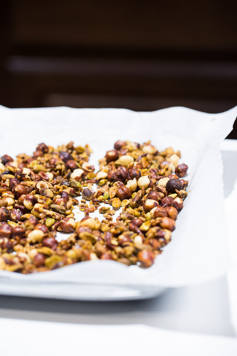 Recipe for spicy candied nuts 1 tablespoon olive oil or neutral tasting oil 1 tablespoon maple syrup ½ teaspoon fine grain salt ⅛ or ¼ teaspoon chipotle powder or cayenne pepper 2 1/2 cups nuts (any combination of your choice is excellent: pistachios, cashews, pecans, walnuts, etc.) Preheat oven to 350 degrees. In a large bowl mix the nuts, add the oil, maple syrup, cayenne or chipotle powder and salt. Mix until all well covered, put on a baking sheet prepared with parchment paper or a silicone mat. Baked in the oven for 10 minutes, rotate the tray and bake for 8-10 more minutes. Remove from the oven and let cool before testing. If you have spare nuts store them in a tightly closed jar for five days, sprinkle over cooked oatmeal for breakfast or over try over a fresh salad.